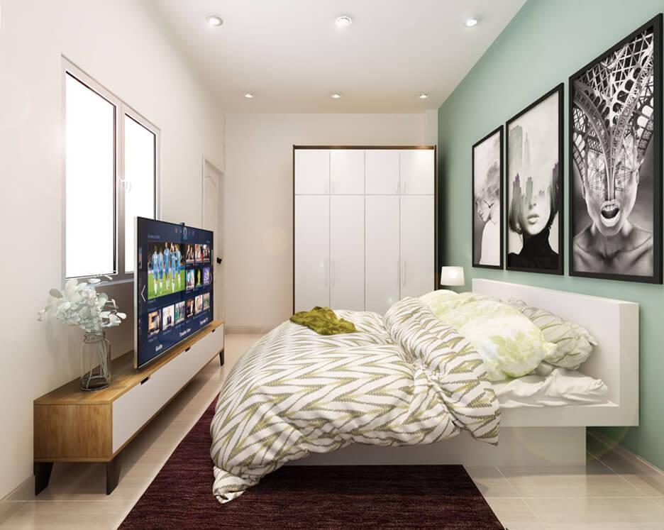 Phòng ngủ bé trai với mãng tường màu xanh làm điểm nhấn