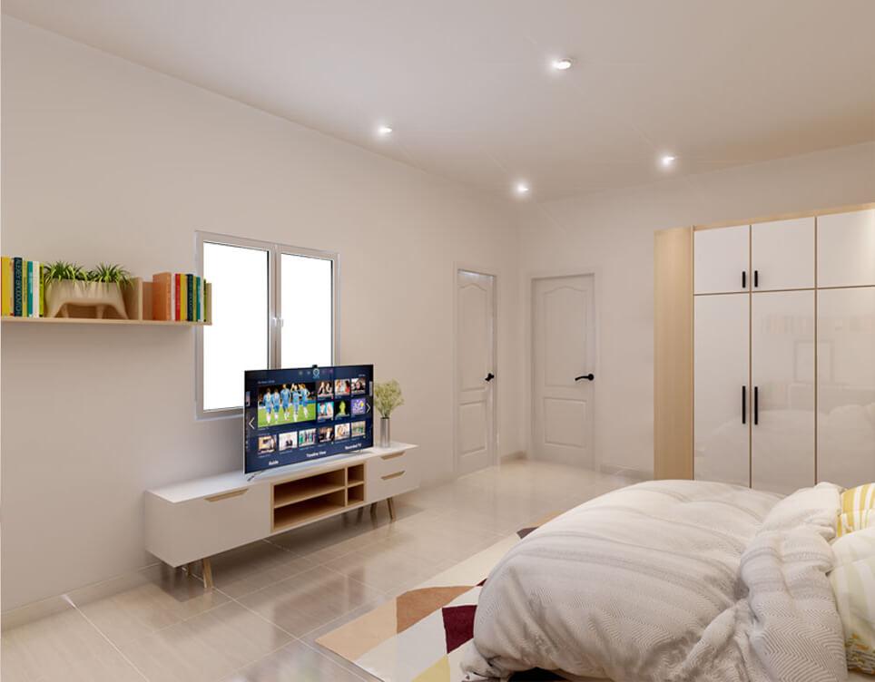 Một chiếc Tủ tivi đơn giản với tông trắng được đặt tại phòng ngủ khách