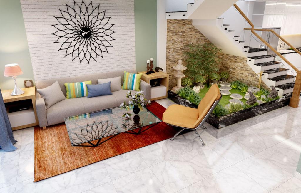 Tận dụng gầm cầu thang để tạo một tiểu cảnh nhỏ làm phòng khách trở nên tươi mát và sống động