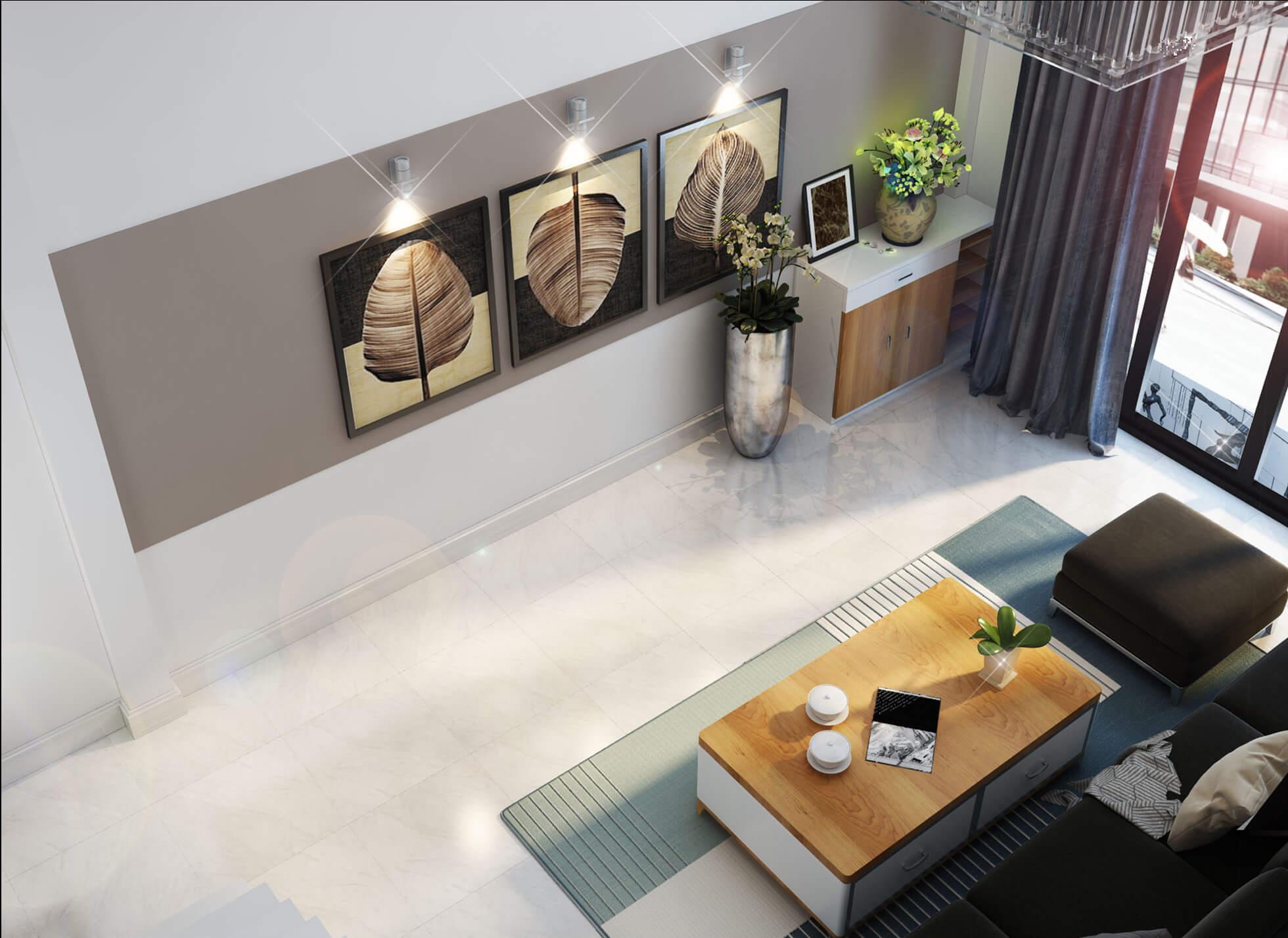 Sử dụng các bức trang treo tường làm điểm nhấn, vừa tạo nét nghệ thuật nơi phòng khách